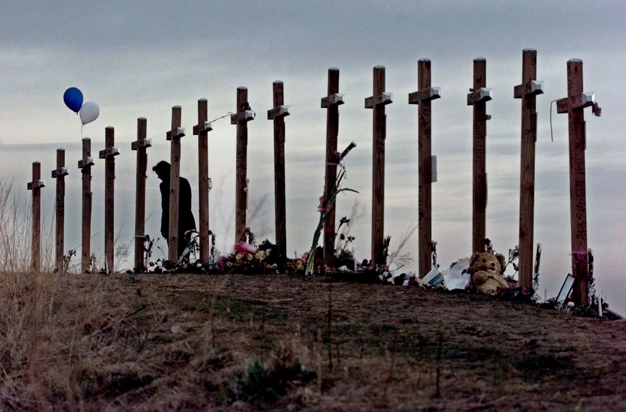 The 15 Columbine Shooting memorial crosses. via www.thenypost.files.wordpress.com
