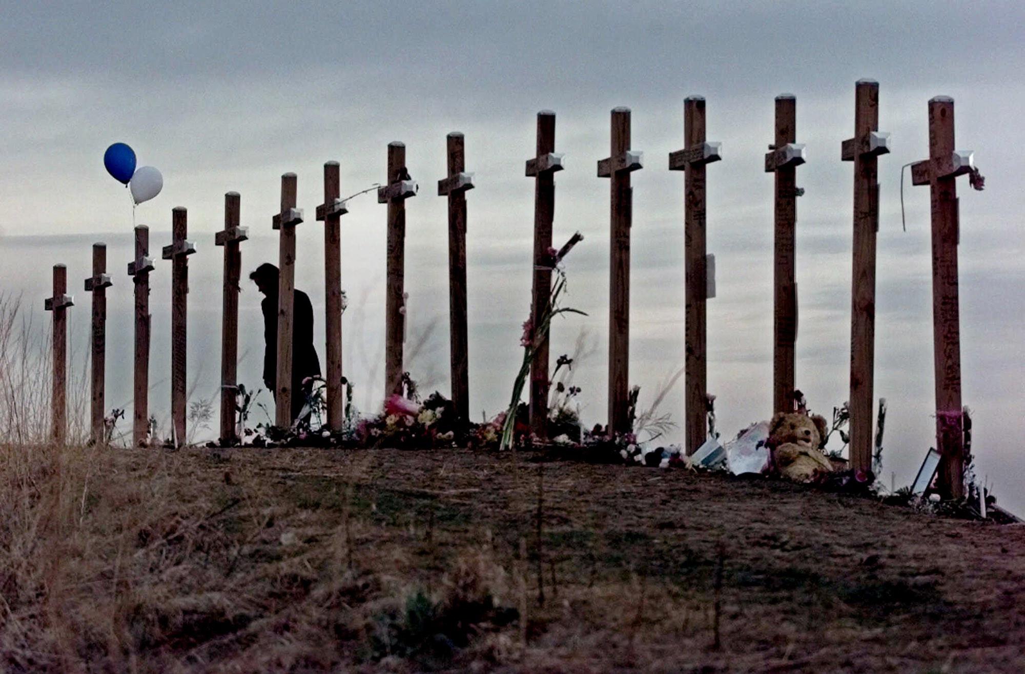 The 15 Columbine Shooting memorial crosses. via www.thenypost.files.wordpress.com