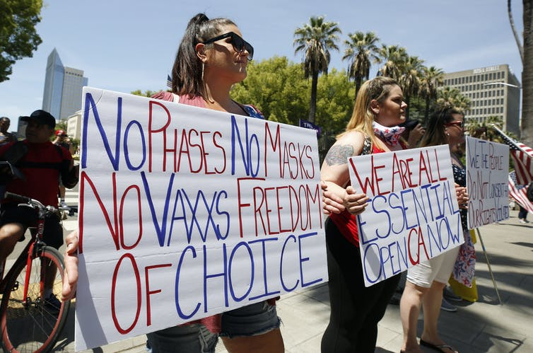 Coronavirus Conspiracy Theories and Reopen Protests as Death Denial